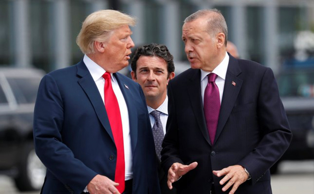 President Recep Tayyip Erdoğan and U.S. President Donald Trump walk as they talk at the start of the NATO summit in Brussels, Belgium, July 11, 2018.