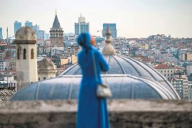 A woman looks on from the terrace of the Süleymaniye Mosque after Ramadan Bayram (Eid al-Fitr) prayers, Istanbul, June 4, 2019.