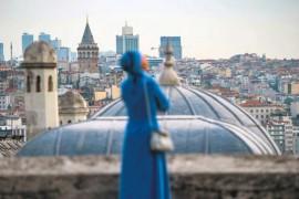 A woman looks on from the terrace of the Süleymaniye Mosque after Ramadan Bayram (Eid al-Fitr) prayers, Istanbul, June 4, 2019.