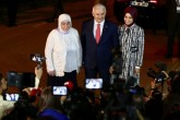 The AK Party's Istanbul mayoral candidate Binali Yıldırım and his family pose for cameras as they arrive for a televised debate with the main opposition CHP's candidate ahead of the June 23 Istanbul elections, Istanbul, June 16, 2019.