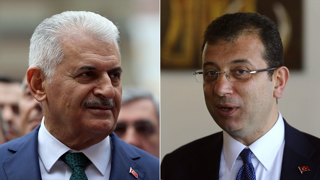 Justice and Development (AK) Party candidate Binali Yildirim (R) and Turkey's main opposition Republican People's Party (CHP) candidate Ekrem Imamoglu (R)