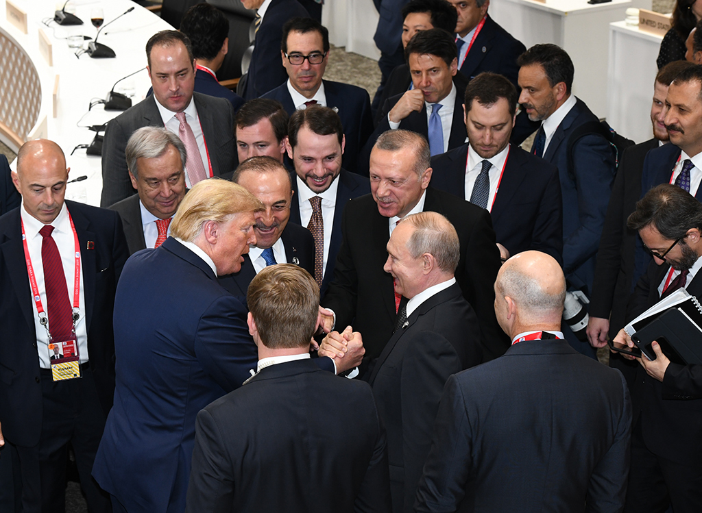President Recep Tayyip Erdoğan (C), U.S. President Donald Trump (L) and Russian President Vladimir Putin (R) have a quick talk during the G20 summit of world leaders in Osaka, Japan, June 30, 2019.