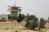 Turkish soldiers stand on a watchtower at the Atmeh crossing on the Syrian-Turkish border, as seen from the Syrian side, in Idlib governorate, Syria, May 31, 2019.