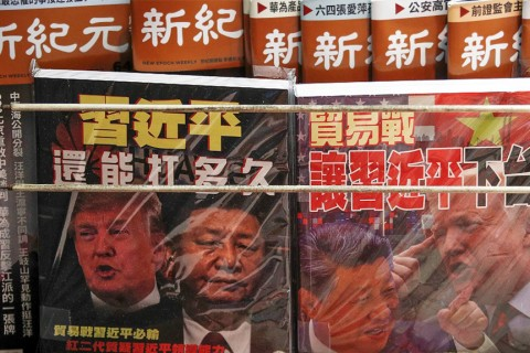 Chinese magazines featuring China's President Xi Jinping and U.S. President Donald Trump on the trade war on sale at a roadside newsstand in Hong Kong, July 4, 2019.