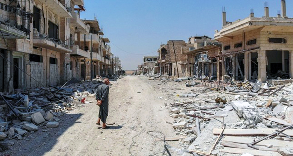 A Syrian man inspects the damage from Assad regime bombing in the town of Khan Sheikhun, Idlib, northern Syria, Aug. 3, 2019.
