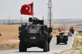A Turkish military patrol on Idlib Highway