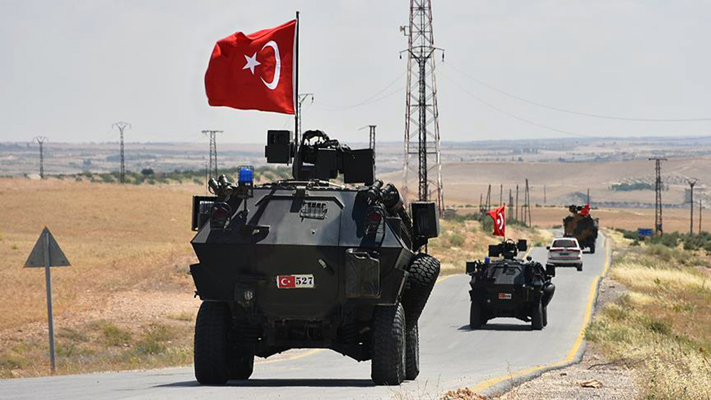 A Turkish military patrol on Idlib Highway