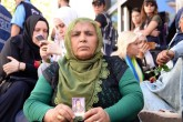 Kurdish mother Hüsniye Kaya holds up a picture of her long-lost daughter 19-year-old Mekiye in front of the HDP headquarters in Diyarbakır, Sept. 8, 2019.