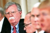 Former U.S. National Security Adviser John Bolton (L) listens to President Donald Trump (R) during a working lunch with Japanese Prime Minister Shinzo Abe at Trump' s private Mar-a-Lago residance in Palm Beach, Fla, April 18, 2018.