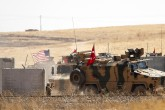 SANLIURFA, TURKEY - SEPTEMBER 08 : A photo taken from Turkey's Sanliurfa province shows the armoured vehicles as Turkey, US start first joint ground patrols as part of efforts to establish safe zone east of Euphrates in Syria on September 08, 2019. First joint Turkish-U.S. ground patrols begin Sunday for a planned safe zone east of Euphrates in Syria. The Turkish Armed Forces (TSK) and U.S. Armed Forces initiated the patrols as part of first phase of safe zone plan. Turkish-flagged six armored vehicles joined the U.S. military convoy 30 kilometers (18.6 miles) away from Akcakale district of southeastern Sanliurfa province.