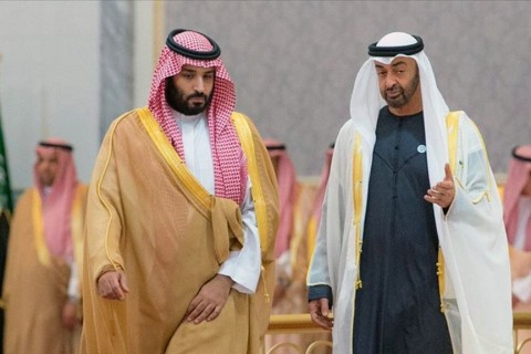 Crown Prince and Defense Minister of Saudi Arabia Mohammad bin Salman al-Saud (L) is welcomed by Crown Prince of Abu Dhabi Mohammed bin Zayed Al Nahyan (R)