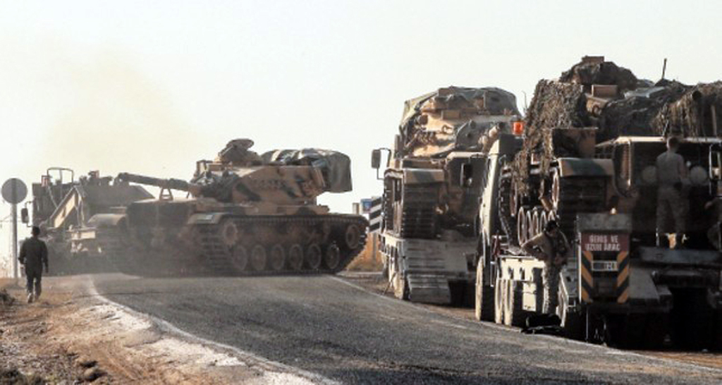 A Turkish tank moves toward the border with Syria in southeastern Şanlıurfa province to join Operation Peace Spring, Oct. 14, 2019.