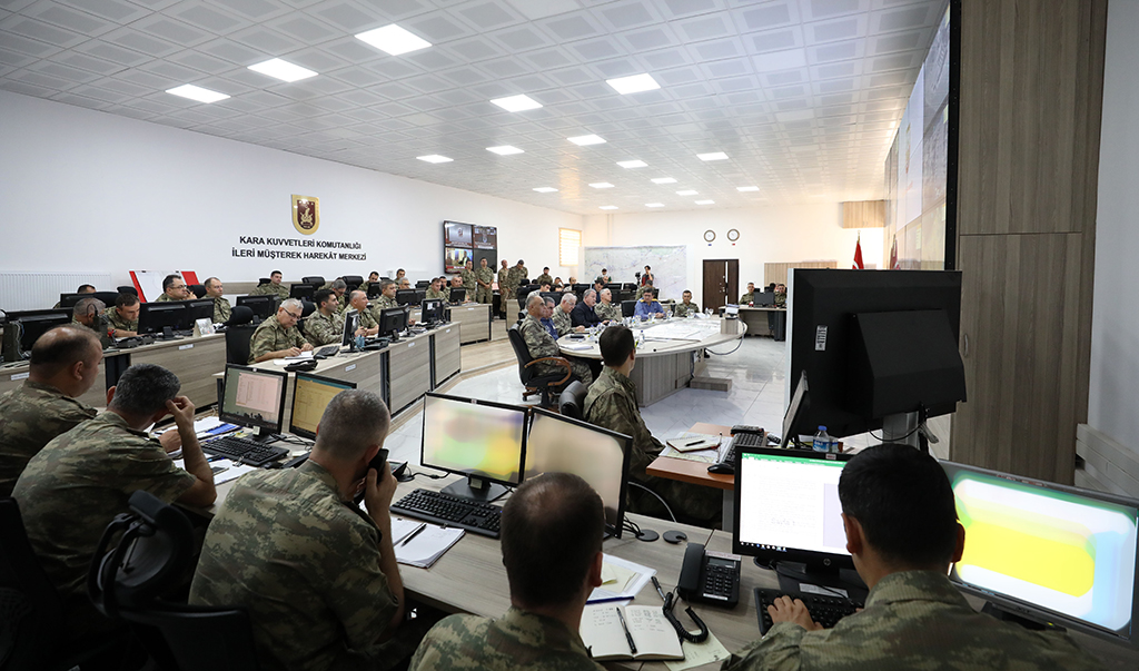 SANLIURFA, TURKEY - OCTOBER 12: Turkish National Defense Minister, Hulusi Akar views the current status on Operation Peace Spring at the Operation Center in Sanliurfa, Turkey on October 12, 2019. Turkish troops along with the Syrian National Army (SNA) began Operation Peace Spring against the PKK/YPG and Daesh terrorists east of the Euphrates River in northern Syria to secure its borders by eliminating terrorist elements and to ensure the safe return of Syrian refugees as well as Syria's territorial integrity.