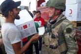 Syrians receive food aid from Turkish Red Crescent in Tal Abyad city center, which was cleared from PKK and YPG, within Turkey's Operation Peace Spring in northern Syria, in Tal Abyad, Syria on October 15, 2019.