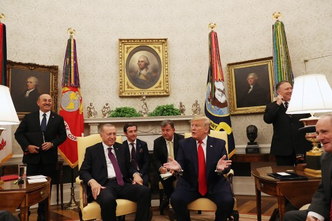 President of Turkey, Recep Tayyip Erdogan (2L) and U.S. President Donald Trump (3R) meet with U.S. senators in the Oval Office at the White House in Washington, United States on November 13, 2019. Foreign Minister of Turkey Mevlut Cavusoglu (L) and his counterpart Mike Pompeo (2R) also attended the meeting.