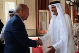 Turkish President Recep Tayyip Erdogan (L) is welcomed by Emir of Qatar Tamim bin Hamad Al Thani (R) in Doha, Qatar on November 25, 2019.