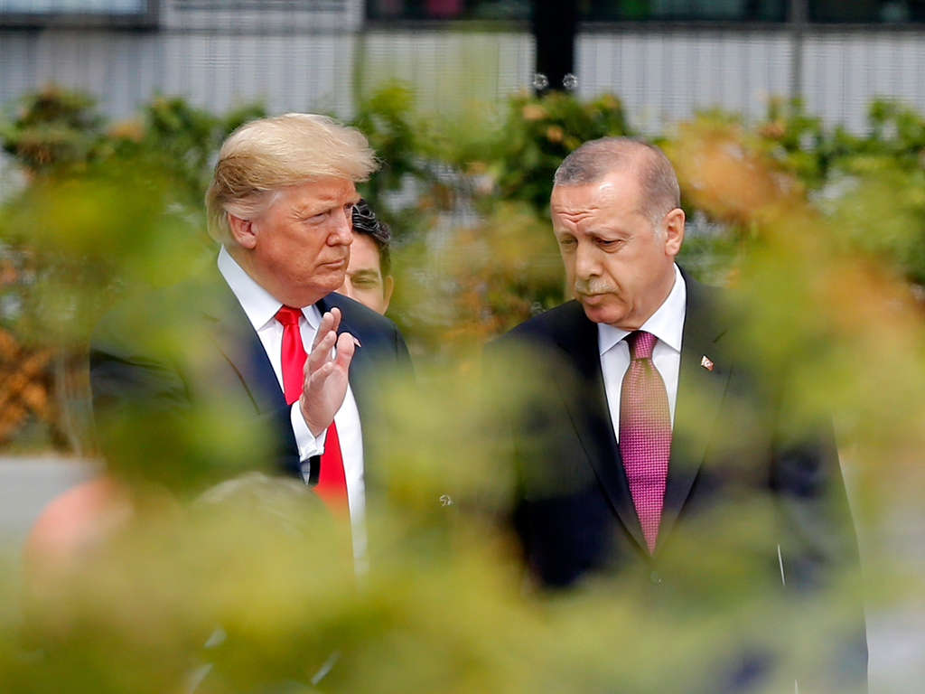 U.S. President Trump (L) and President Erdoğan (R) talk while walking to attend the NATO Brussels Summit, Belgium, July 11, 2018.