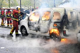 Firefighters try to extinguish a burning car during 'Gilets Jaunes' (Yellow Vests) protests on Place d'Italie marking the first anniversary of the movement, in Paris, France on November 16, 2109. ( Mustafa Yalçın - Anadolu Agency )