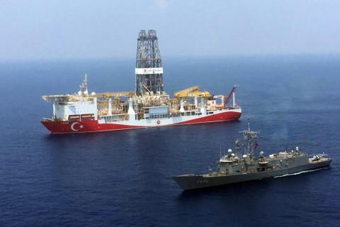An aerial photo shows Turkish-flagged drill ship Yavuz' continue offshore drilling operations in company with Turkish battleship in the west of the Island of Cyprus in the Mediterranean Sea.