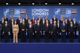 (Front row ) Britain's Prime Minister Boris Johnson (C), NATO Secretary General Jens Stoltenberg(C-R), US President Donald Trump (5th R) and President of Turkey Recep Tayyip Erdogan (4th R) , (middle row) France's President Emmanuel Macron, German Chancellor Angela Merkel, Greek Prime Minister Kyriakos Mitsotakis, Hungary's Prime Minister Viktor Orban, Iceland's Prime Minister Katrin Jakobsdottir, (top row) Netherland's Prime Minister Mark Rutte, Norway's Prime Minister Erna Solberg, Lithuania's Prime Minister Saulius Skvernelis, Portugal's Prime Minister Antonio Costaa and Montenegro's Prime Minister Dusko Markovic pose for the family photo at the NATO summit at the Grove Hotel in London on December 4, 2019.