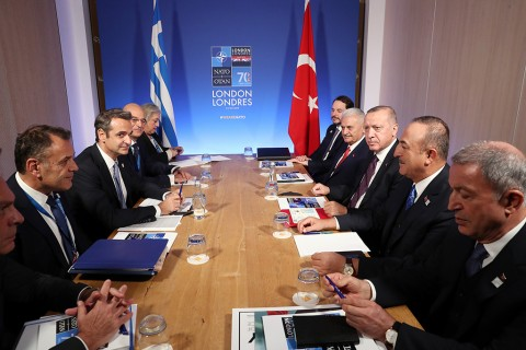 Turkish President Recep Tayyip Erdogan (3rd R) meets with Greek Prime Minister Kyriakos Mitsotakis (3rd L) within the NATO Leaders' Summit at the Grove Hotel in London on December 04, 2019. Turkish Foreign Minister Mevlut Cavusoglu (2nd R), Turkish Treasury and Finance Minister Berat Albayrak (5th R), Turkish Defense Minister Hulusi Akar (R) and AK Party's Izmir Deputy, Binali Yildirim (4th R) also attended the meeting.