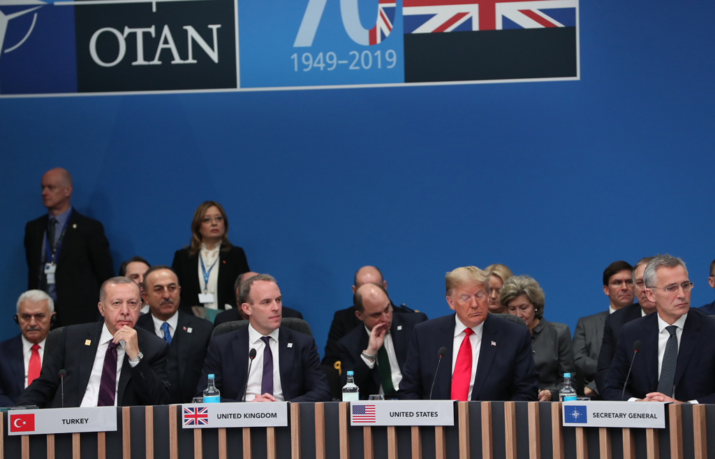 Turkish President Recep Tayyip Erdogan (L), NATO Secretary General Jens Stoltenberg (R), US President Donald Trump (2nd R) and British Foreign Minister Dominic Raab attend NATO Leaders' Summit at the Grove Hotel in London on December 4, 2019.