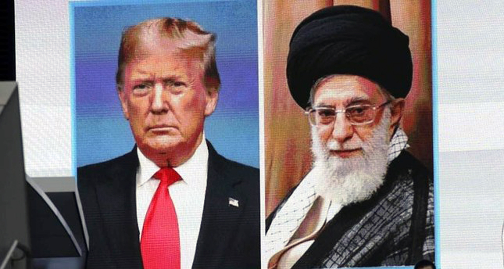 A man walks by a huge screen showing U.S. President Donald Trump (L) and Iranian Supreme Leader Ali Khamenei, Tokyo, Jan. 8, 2020. (AP Photo)