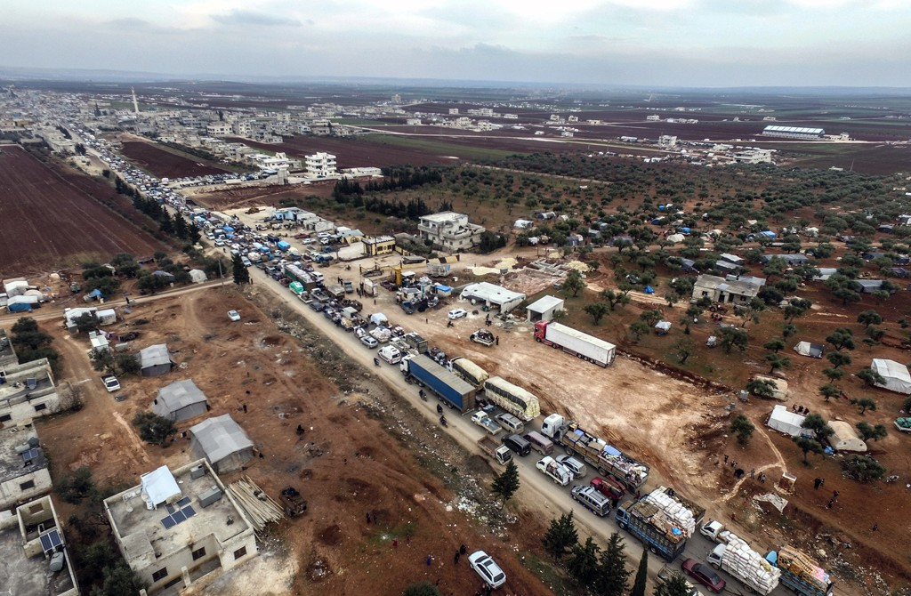 A drone photo shows a view of Syrian civilians' convoy, who are being forcibly displaced due to the ongoing attacks carried out by Assad regime, Russia and Iran-backed groups, and are on their way to safer zones with their belongings near Turkish border, in Idlib, Syria on February 5, 2020. The ongoing attacks by Bashar al-Assad regime in Syria and its allies forced civilians to flee their homes in Idlib, a de-escalation zone in northwestern Syria. Around 150.000 more civilians have left their homes in Idlib de-escalation zone in northwestern Syria over the last days due to attacks by regime forces and their allies.