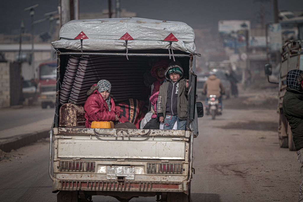 Syrian families, who have been forced to displace due to the ongoing attacks carried out by Assad regime and Russia, are seen on their way to safer zones with their belongings, from Daret Izze, Etarib regions in Idlib, Syria on February 11, 2020. More than 27.000 civilians have fled their homes falling inside the Idlib de-escalation zone in Syria over the last four days due to attacks of regime and its allies.