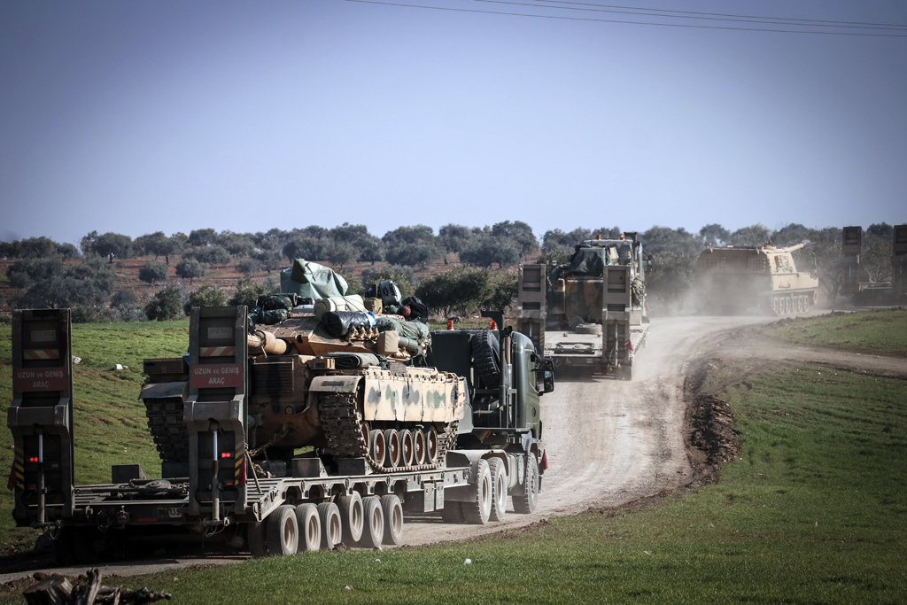 Total of 150 military vehicles of Turkish Armed Forces' pass through Reyhanli district of Turkey's Hatay as they are being deployed to Syria border as reinforcements, including howitzers, tanks, ammunition, armored construction machines and other military vehicles on February 17, 2020.