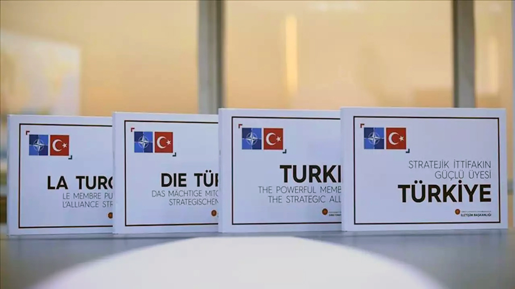 Turkey's president presented a book about the country's role in NATO to the leaders of Germany, France and Britain during a quartet meeting in the U.K.  Recep Tayyip Erdogan presented Turkey: The Powerful Member of the Strategic Alliance published by the Turkish Communications Directorate to French President Emmanuel Macron, German Chancellor Angela Merkel and the British Prime Minister Boris Johnson.  Published in Turkish, English, French and German, the book provides detailed information about the duties and contributions of NATO member Turkey to the alliance.  The book, which touches on the perspectives of Turkey and other countries regarding NATO, also has a chapter on Turkey's expectations from the alliance.  The chapter highlighted the common fight against terrorism as well as the expected continuation of NATO's contributions to Turkey's defense.  Turkey's expectations regarding contributions of NATO members to the establishment of a safe zone in northern Syria were also expressed in this section.  The book was also presented to U.S. President Donald Trump and his delegation during Erdogan's visit to the U.S..
