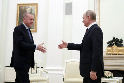 President Recep Tayyip Erdoğan and Russian President Vladimir Putin greet each other prior to their talks on Idlib, at the Kremlin in Moscow, Russia, March 5, 2020. (AP Photo)