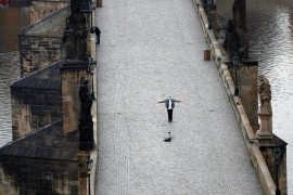 A man takes a selfie on the nearly empty Charles Bridge in Prague, Czech Republic, Friday, March 20, 2020. (AP Photo)