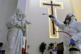 BEIRUT, LEBANON - MARCH 05 : A health official wearing protective suit sprays disinfectant at a church as a precaution against the coronavirus (Covid-19) in Beirut, Lebanon on March 05, 2020.  (Hussam Chbaro - Anadolu Agency)