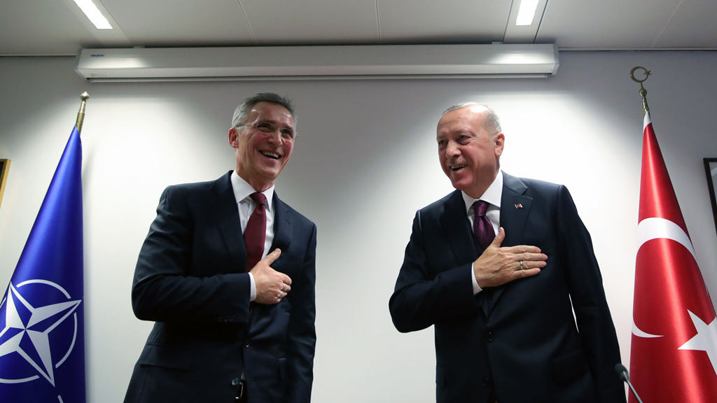 President Recep Tayyip Erdoğan (right) and NATO Secretary-General Jens Stoltenberg perform the traditional hands-free Turkish greeting following a meeting in Brussels on March 10, 2020. (AA Photo)