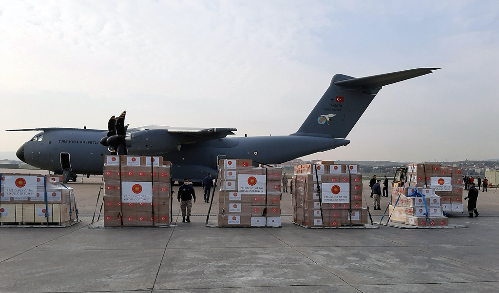 Soldiers prepare to load a military cargo plane with personal protection equipment heading to Italy and Spain to help the countries combat the coronavirus outbreak, Ankara, Wednesday, April 1, 2020. (AP Photo)
