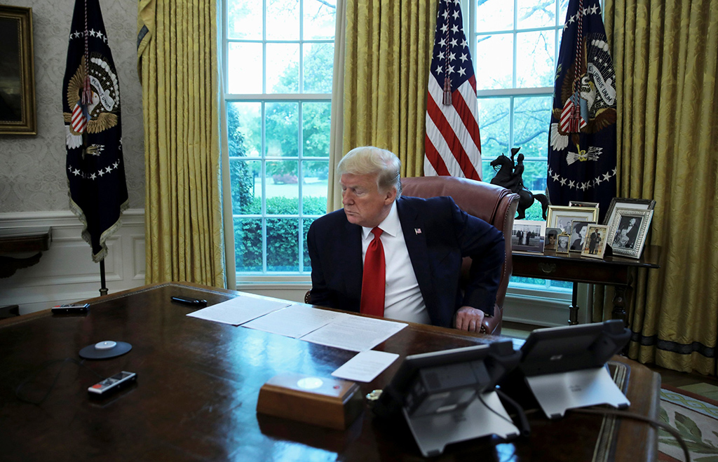 U.S. President Donald Trump looks at his briefing papers at the start of an interview with Reuters about China, in the Oval Office of the White House in Washington, D.C., U.S., April 29, 2020. (Reuters Photo)