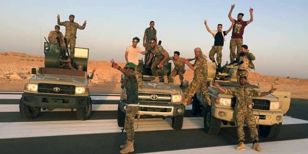 Members of The Libyan Army celebrate after they liberated the strategic Bani Waled city, where warlord Khalifa Haftar left in Libya on June 05, 2020.