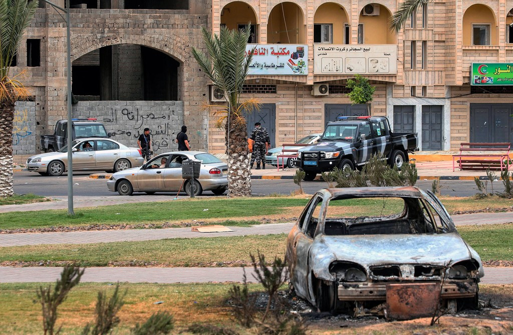 Members of security forces affiliated with the Libyan Government of National Accord (GNA)'s Interior Ministry stand at a make-shift checkpoint in the town of Tarhuna, about 65 kilometers southeast of the capital Tripoli, Libya, June 11, 2020. (AFP Photo)