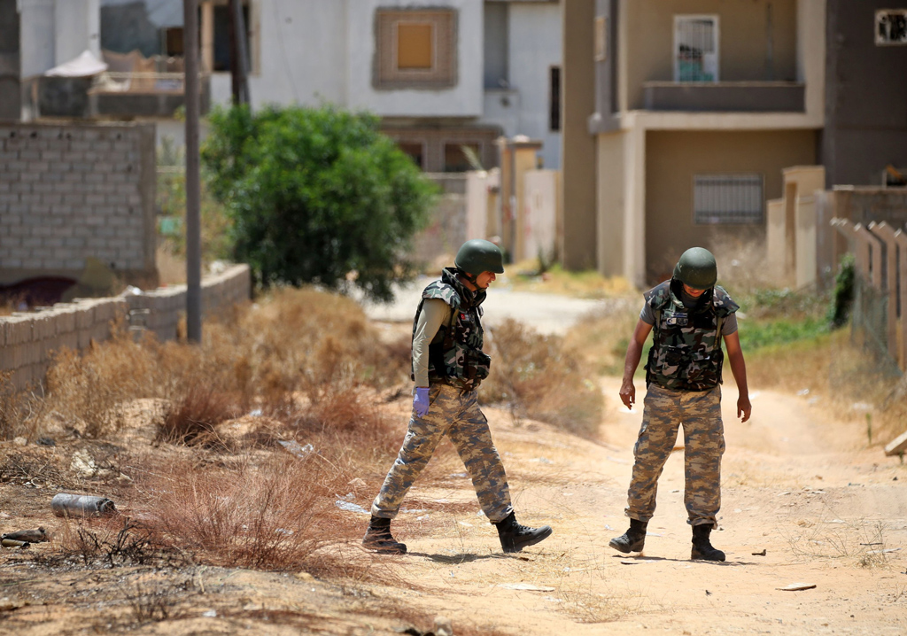 Turkish deminers search and clear landmines in the Salah al-Din area, south of the Libyan capital Tripoli, June 15, 2020. (AFP Photo)