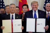 "U.S. President Donald Trump stands Chinese Vice Premier Liu He after signing ""phase one"" of the U.S.-China trade agreement in the East Room of the White House in Washington, U.S., January 15, 2020."