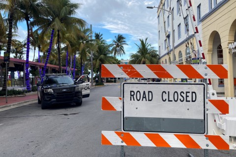 A police vehicle is parked next to a barrier blocking a street prior to the 8 p.m. curfew, imposed due to Florida's climbing numbers of coronavirus cases, in Miami Beach, Florida, U.S., July 18, 2020. (Reuters Photo)