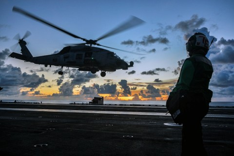An MH-60R Sea Hawk helicopter launches during flight operations aboard the U.S. Navy aircraft carrier USS Ronald Reagan in the South China Sea, July 17, 2020. (Reuters Photo)