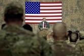 U.S. President Donald Trump speaks to members of the military at a hangar rally at al-Asad Air Base, Iraq, Dec. 26, 2018. (AP Photo)