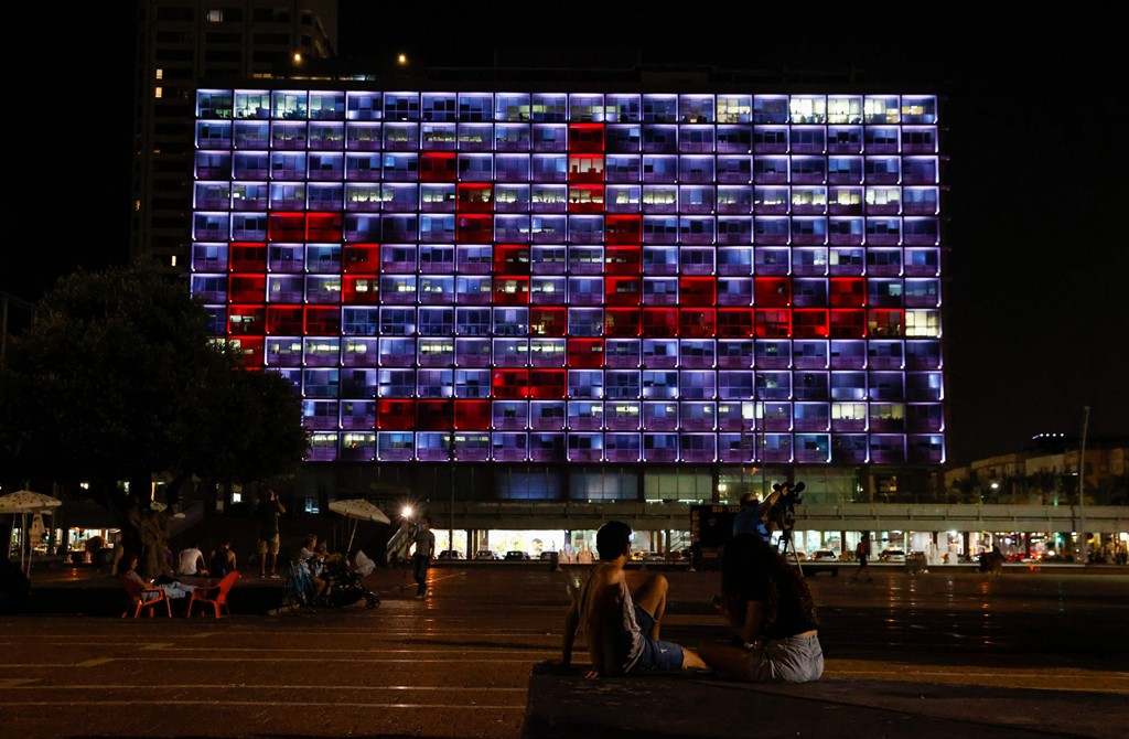 """The windows of the Tel Aviv-Yafo Municipality building are illuminated with the word """"peace"""" in Arabic, to celebrate the signing of the landmark Israeli normalization deals with the United Arab Emirates and Bahrain, Tel Aviv, Israel, Sept. 15, 2020. (AFP Photo)"""