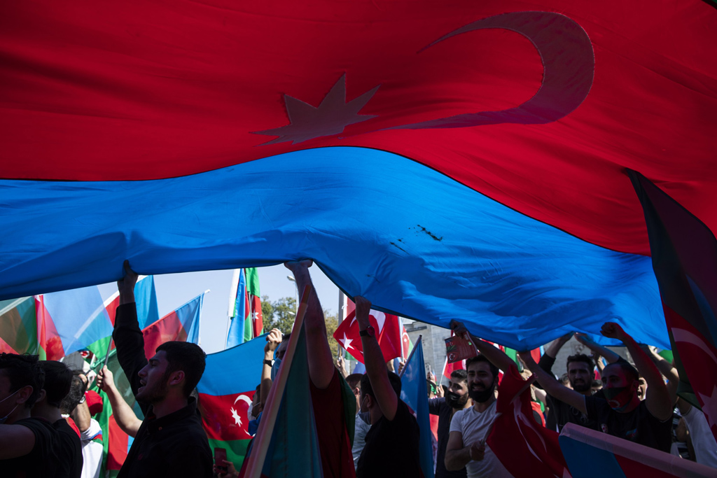 Protesters wave a huge Azerbaijani flag in demonstrations against Armenia in Istanbul, Turkey, Oct. 4, 2020. (EPA Photo)