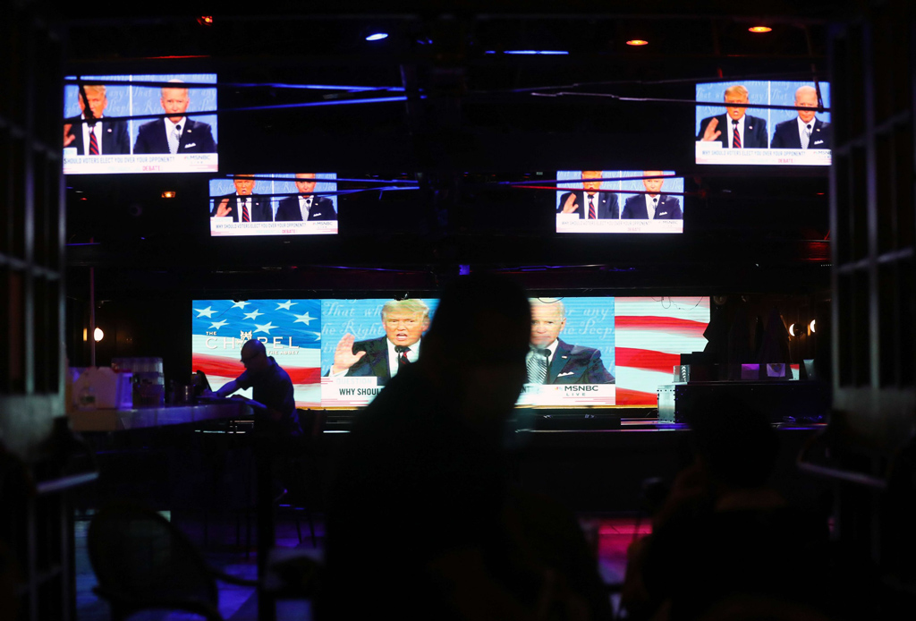 A broadcast of the first debate between U.S. President Donald Trump and Democratic presidential nominee Joe Biden is shown on televisions, in West Hollywood, California, U.S., Sept. 29, 2020. (AFP Photo)