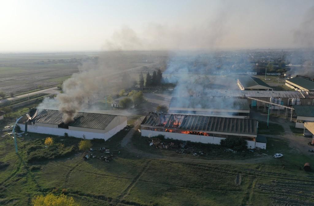 A cotton factory burns following Armenian artillery fire despite a cease-fire agreement between Baku and Yerevan, in a village in the Azerbaijani city of Tartar, Oct. 19, 2020. (AA Photo)