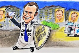 French President Emmanuel Macron with the magazine Charlie Hebdo that presents disrespect and hate crimes as freedom