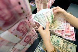 US Dollar and Chinese Yuan banknotes